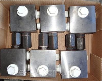 Редукционный клапан на гидравлическую систему экскаватора ЭКГ-5
